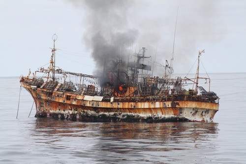 A plume of smoke rises from the derelict Japanese ship Ryou-Un Maru after it was hit by canon fire by a U.S. Coast Guard cutter on Thursday, April 5, 2012, in the Gulf of Alaska. The Coast Guard decided to sink the ship dislodged by last year's tsunami because it was a threat to maritime traffic and could have an environmental impact if it grounded. (AP Photo/U.S. Coast Guard)