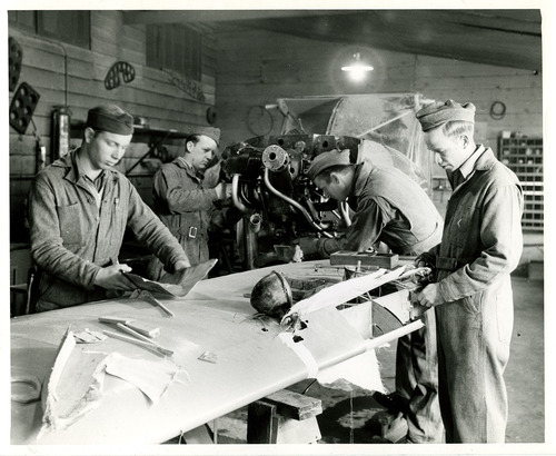 Tribune file photo  This 1943 photo from the Works Progress Administration shows men in an airplane repair class.