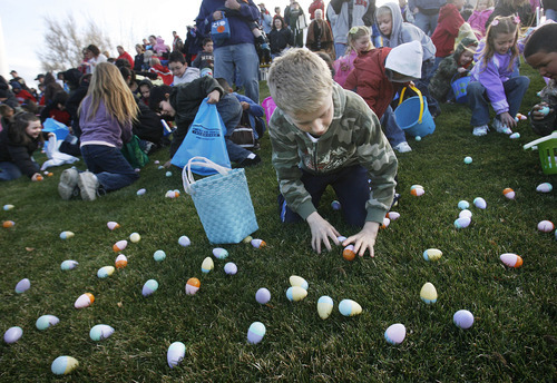 Scott Sommerdorf  Tribune file photo Hundreds of kids scramble for their share of Easter eggs in this 2009 hunt at the Bees ballpark. Several egg hunts take place this weekend at various locations.