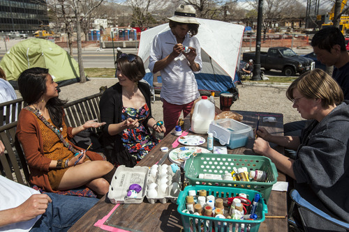 Chris Detrick  |  The Salt Lake Tribune Members of Occupy SLC paint eggs Saturday at their new home in Library Square. Since Oct. 6, the Salt Lake contingency has stood in solidarity with Occupy Wall Street, a grass-roots movement decrying corporate greed and its influence on society and the political process.