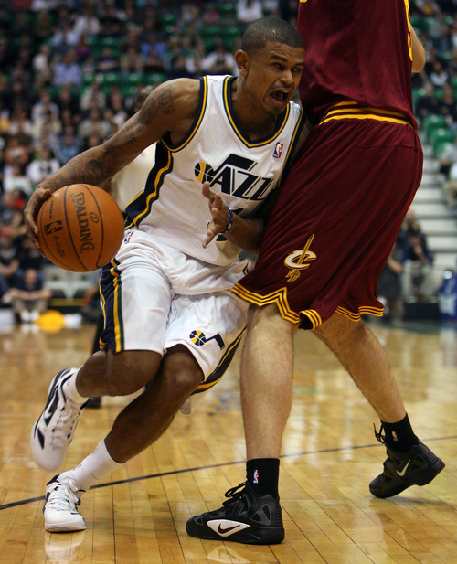 Steve Griffin  |  The Salt Lake Tribune  Utah's Earl Watson crashes into Cleveland's Semih Erden during first half action in the Jazz Cleveland game at EnergySolutions Arena in Salt Lake City, Utah  Tuesday, January 10, 2012.