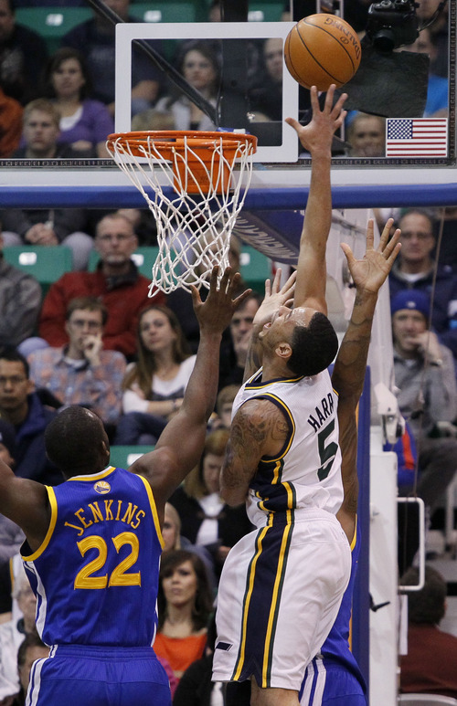 Utah Jazz point guard Devin Harris (5) scores against Golden State Warriors guard Charles Jenkins (22) during the first half of an NBA basketball game, Friday, April 6, 2012, in Salt Lake City.  (AP Photo/Colin E Braley)