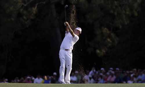 Bubba Watson hits off the 18th fairway during the fourth round of the Masters. Watson won the tournament on the second hole of a playoff against Louis Oosthuizen.  (AP Photo/David J. Phillip)