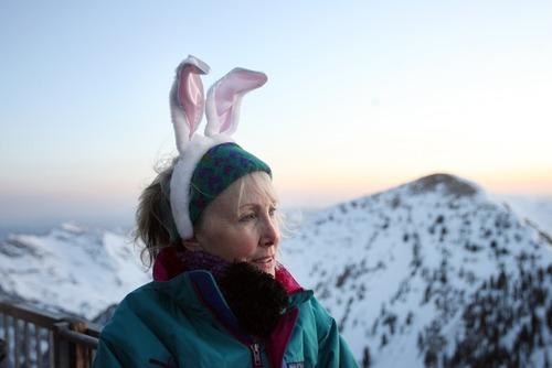 Kim Raff  |  The Salt Lake Tribune Jude Scott watches the sunrise before an Easter sunrise service on Hidden Peak at Snowbird Ski Resort on Sunday, April 8, 2012.