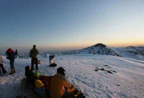 Kim Raff  |  The Salt Lake Tribune People watch the sunrise during an Easter service on top of Hidden Peak at Snowbird Ski Resort on Sunday, April 8, 2012.