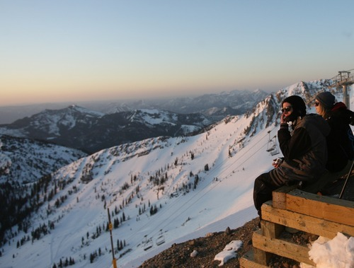 Kim Raff  |  The Salt Lake Tribune Tayler Barnes, left and Kaitlin Jacobs watch the sunrise during an Easter service on top of Hidden Peak at Snowbird Ski Resort on Sunday, April 8, 2012.