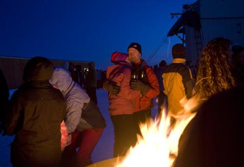 Kim Raff  |  The Salt Lake Tribune People gather around fire pits on Hidden Peak before sunrise for an Easter sunrise service at Snowbird Ski Resort on Sunday, April 8, 2012.