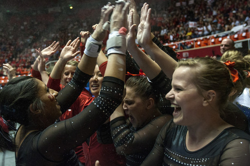 Chris Detrick  |  The Salt Lake Tribune Utah's Kassandra Lopez celebrates with her teammates after competing on the bars on the floor exercise during the NCAA gymnastics Regionals at the Huntsman Center Saturday April 7, 2012. Lopez finished in 2nd place with a score of 9.8750. Utah won the meet with a score of 196.8250 and will compete in the national championship April 20-22 in Duluth, Georgia.