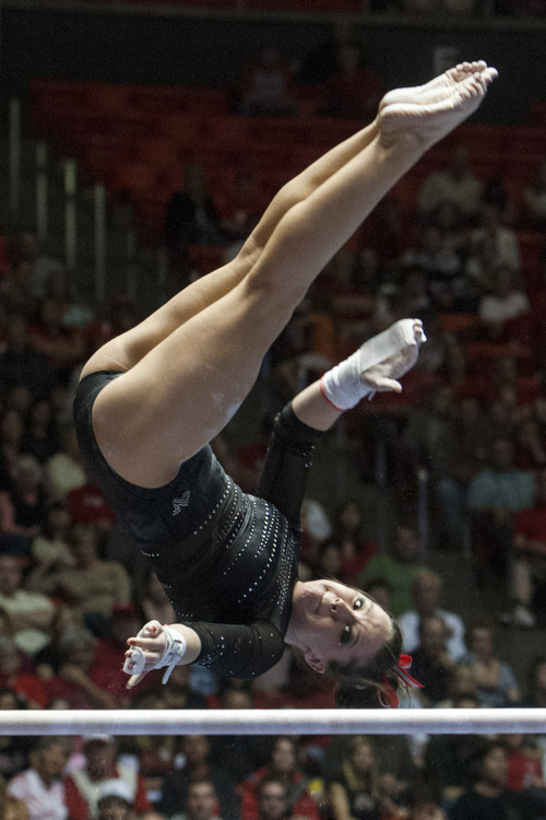 Chris Detrick  |  The Salt Lake Tribune Utah's Stephanie McAllister competes on the bars during the NCAA gymnastics Regionals at the Huntsman Center Saturday April 7, 2012. Utah won the meet with a score of 196.8250 and will compete in the national championship April 20-22 in Duluth, Georgia.