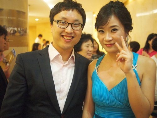 Courtesy of the Lee family Samuel Lee with his wife, Oh Seungmi, at her piano concert in 2011.