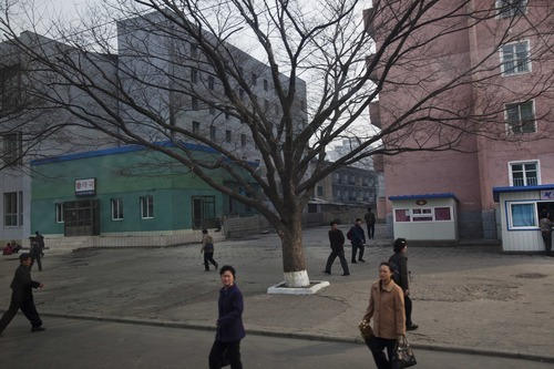 Residents of Pyongyang, North Korea walk along a street in the capital's downtown on Tuesday April 10, 2012. North Korean space officials said Tuesday that all assembly and preparations for a planned satellite launch have been completed, while denying it is a cover for missile test. (AP Photo/David Guttenfelder)