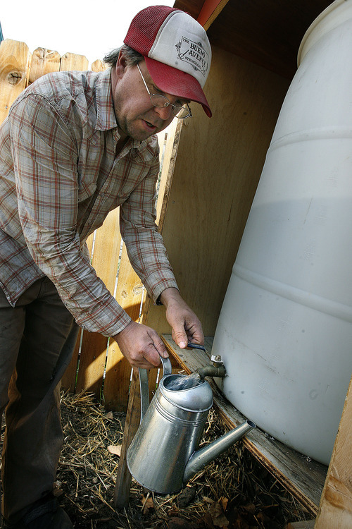 Scott Sommerdorf  |  The Salt Lake Tribune              Salt Lake City resident Chris Gleason pours water from a rainwater collection system he built at his Salt Lake City home, Monday, March 25, 2012. Gleason is the author of several how-to books. His most recent is