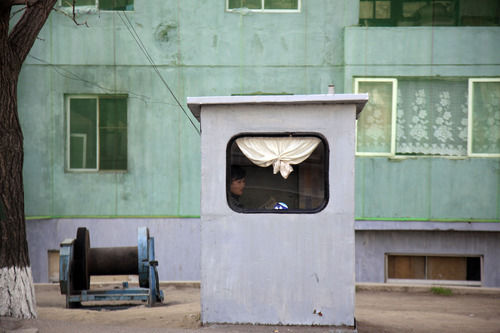 In this photo taken Monday, April 9, 2012, a woman sits inside a booth on a street in Pyongyang, North Korea. Workers' Party delegates are scheduled to convene Wednesday, April 11, 2012 for the fourth conference of North Korea's ruling political party, where new leader Kim Jong Un is expected to inherit titles once held by his father, the late Kim Jong Il. (AP Photo/Ng Han Guan)