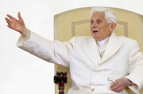 Pope Benedict XVI waves to faithful during his weekly audience in St. Peter's square at the Vatican, Wednesday, April 11, 2012. (AP Photo/Riccardo De Luca)