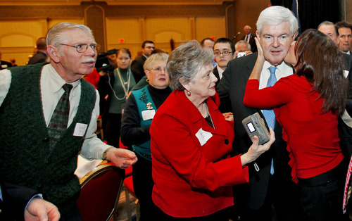 Former House Speaker and current presidential candidate Newt Gingrich is surrounded by supporters after speaking at a Virginia GOP fundraiser in Henrico County, just outside of Richmond, Va., Thursday, Dec. 22, 2011. (AP Photo/Richmond Times-Dispatch, Mark Gormus)