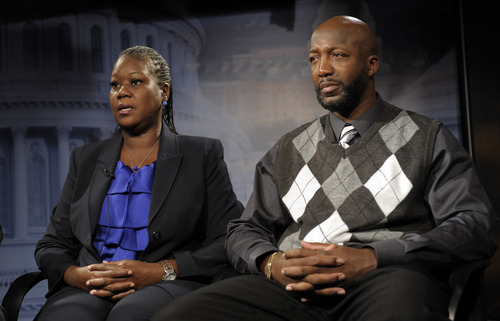The parents of Trayvon Martin, mother  Sybrina Fulton, left, and father Tracy Martin are interviewed by The Associated Press in Washington, Wednesday, April 11, 2012.  After weeks of mounting tension and protests across the U.S., a special prosecutor has decided to bring charges against neighborhood watch volunteer George Zimmerman in the killing of 17-year-old Trayvon Martin, a law enforcement official said Wednesday.  (AP Photo/Susan Walsh)