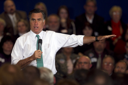 Republican presidential candidate, former Massachusetts Gov. Mitt Romney, speaks to a crowd during a campaign event, in Warwick, R.I., Wednesday, April 11, 2012. (AP Photo/Steven Senne)