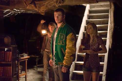 In this film image released by Lionsgate, from left, Fran Kranz, Chris Hemsworth and Anna Hutchison are shown in a scene from