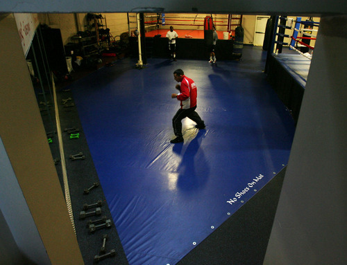 Steve Griffin/The Salt Lake Tribune   Isaac Aguilar is perhaps the state's best amateur boxer. He will be fighting in the Golden Gloves Western Regional this weekend in Murray. Here, Aguilar warms up before sparing at the Muay Thai Institute in Salt Lake City on April 10, 2012.