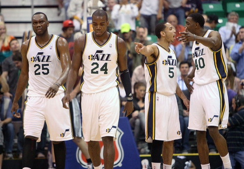Steve Griffin/The Salt Lake Tribune   Utah's Devin Harris and Jeremy Evans argue as Al Jefferson and Paul Millsap leave the court frustrated after not coming up with a shot in the last seconds of the first half in the Jazz versus Spurs game at EnergySolutions Arena in Salt Lake City Monday April 9, 2012.