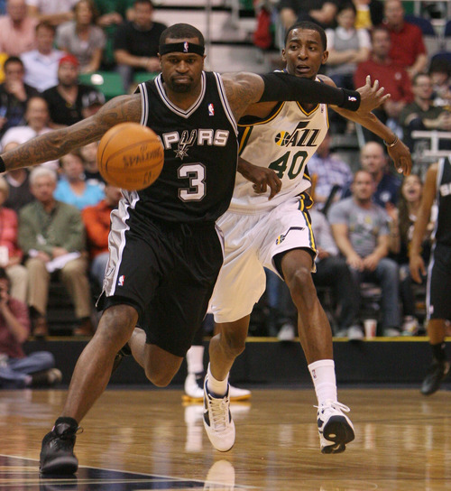 Steve Griffin/The Salt Lake Tribune   San Antonio's Stephan Jackson keeps Utah's Jeremy Evans away from a loose ball during first half action in the Jazz versus Spurs game at EnergySolutions Arena in Salt Lake City Monday April 9, 2012.
