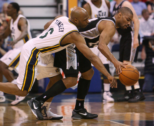 Steve Griffin/The Salt Lake Tribune   Utah's Jamaal Tinsley, left, tries to stripe the ball from San Antonio's  during first half action in the Jazz versus Spurs game at EnergySolutions Arena in Salt Lake City Monday April 9, 2012.