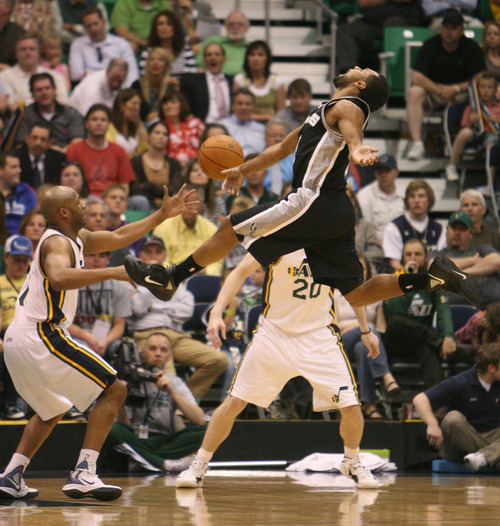 Steve Griffin/The Salt Lake Tribune   Utah's Jamaal Tinsley stripes the ball from San Antonio's Patrick Mills during second half action in the Jazz versus Spurs game at EnergySolutions Arena in Salt Lake City Monday April 9, 2012.