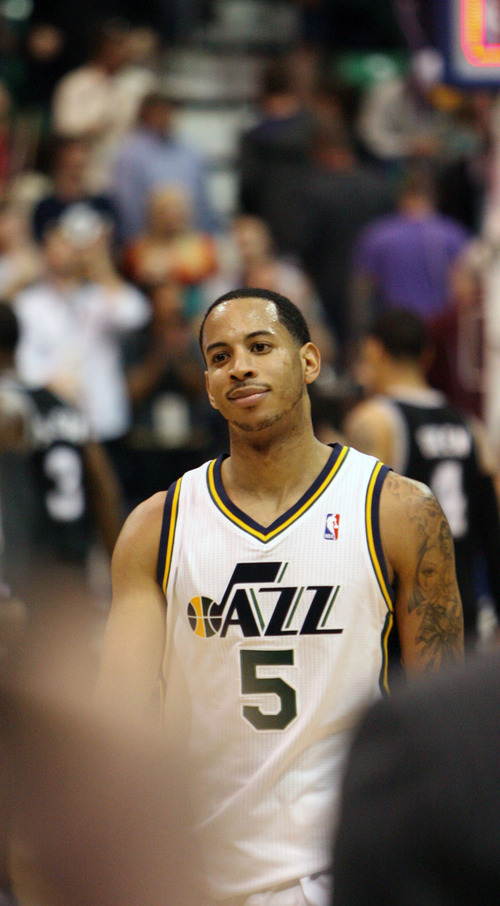 Steve Griffin/The Salt Lake Tribune   Utah's Devin Harris smiles as he walks off the court after Jazz defeated  the San Antonio Spurs at EnergySolutions Arena in Salt Lake City Monday April 9, 2012. Harris had a huge fourth courter leading the Jazz to victory.