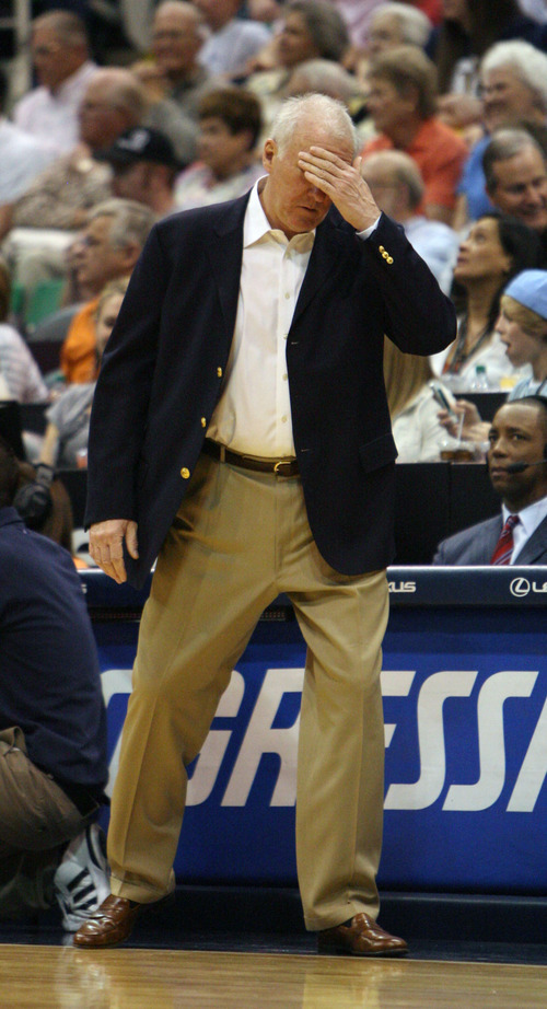Steve Griffin/The Salt Lake Tribune   Spurs head coach Greg Popovich wipes his forehead as the Jazz pull away from the Spurs in the second half at EnergySolutions Arena in Salt Lake City Monday April 9, 2012.