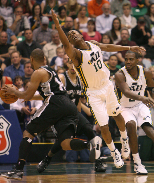 Steve Griffin/The Salt Lake Tribune   Utah's Alec Burks just misses deflecting a pass against the San Antonio Spurs at EnergySolutions Arena in Salt Lake City Monday April 9, 2012. Harris had a huge fourth courter leading the Jazz to victory.