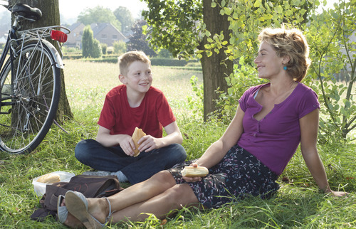 Cyril (Thomas Doret, left) and his new foster-mom Samantha (Cécile De France) enjoy a picnic in the Dardennes brothers'