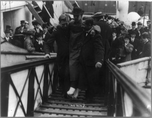 Library of Congress photo  Harold Bride, surviving wireless operator of the Titanic has his feet bandaged as he is carried to help.