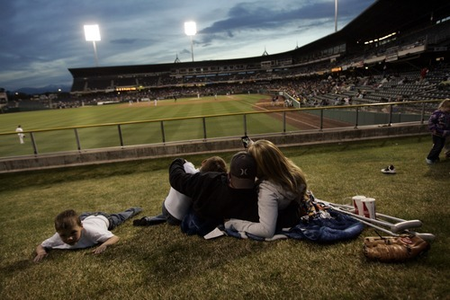 Kim Raff   The Salt Lake Tribune (from left) Bridger Dodge, Logan Dodge, Nick Dodge and Bree Shober sit in the outfield and watch the Bees homeopener against Tucson Padres at Spring Mobile Ballpark in Salt Lake City, Utah on April 13, 2012.