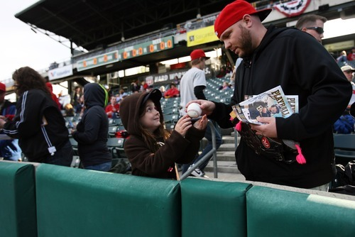Kim Raff   The Salt Lake Tribune McKenzie Christiansen gives her autographed ball to her father Tim Christiansen during the Bees homeopener against Tucson Padres at Spring Mobile Ballpark in Salt Lake City, Utah on April 13, 2012.