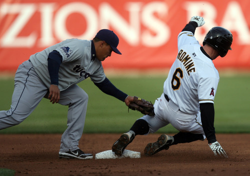Kim Raff   The Salt Lake Tribune Bees player Andrew Romine safely slides into second before the tag from Tucson player Everth Cabrera during the Bees homeopener against Tucson Padres at Spring Mobile Ballpark in Salt Lake City, Utah on April 13, 2012.