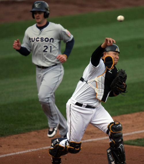 Kim Raff   The Salt Lake Tribune Bees catcher Hank Conger tries to turn a double play after tagging Tucson player Sawyer Carroll out at home during the Bees homeopener against Tucson Padres at Spring Mobile Ballpark in Salt Lake City, Utah on April 13, 2012.