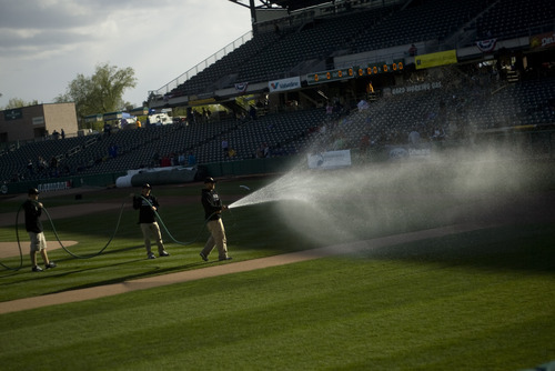 Kim Raff   The Salt Lake Tribune The ground crews ready the field for play during the Bees home opener against Tucson Padres at Spring Mobile Ballpark in Salt Lake City, Utah on April 13, 2012.