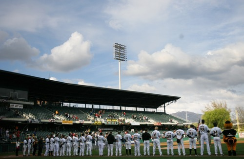 Kim Raff   The Salt Lake Tribune The Bees players line up on the field for the Pledge of Allegiance during the Bees home opener against Tucson Padres at Spring Mobile Ballpark in Salt Lake City, Utah on April 13, 2012.