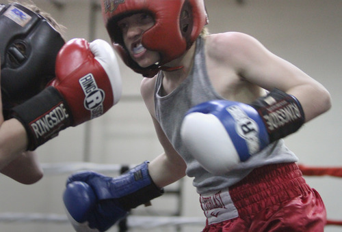 Rick Egan    The Salt Lake Tribune   Braedon Vinison, West Valley, (left) fights Blake Gircke, Montana, (right), in the 82 lb division, in the Rocky Mountain Golden Gloves Regionals at the Sports Mall in Murray, Saturday, April 14, 2012.