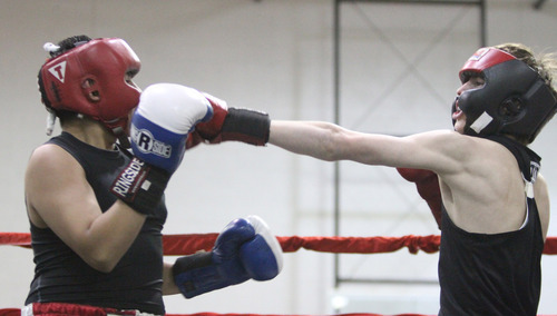 Rick Egan    The Salt Lake Tribune   Bladimir Estrada , City Center (left) fights Tyron Labuff, Montana (right) in the125 lb division, in the Rocky Mountain Golden Gloves Regionals at the Sports Mall in Murray, Saturday, April 14, 2012.