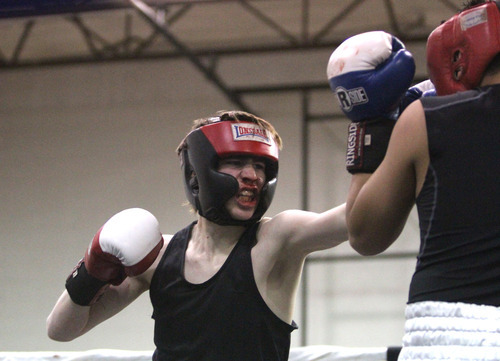 Rick Egan    The Salt Lake Tribune   Tyron Labuff, Montana (left) fights Bladimir Estrada, City Center (right) in the125 lb division, in the Rocky Mountain Golden Gloves Regionals at the Sports Mall in Murray, Saturday, April 14, 2012.