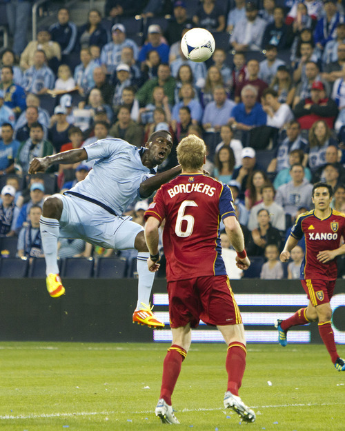 Sporting Kansas City's CJ Sapong leaps high to attempt to head the ball into the goal against Real Salt Lake during an MLS soccer match, Saturday, April 14, 2012, in Kansas City, Kan. Sporting Kansas City won 1-0. (AP Photo/The Kansas City Star, Andy Lundberg)