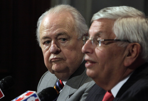 New Orleans Saints owner Tom Benson, left, listens as NBA Commissioner David Stern answers a question at a news conference after the NBA Board of Governors meetings, in New York,  Friday, April 13, 2012. Benson brought stability to the Saints nearly three decades ago and now plans to do the same for the Hornets in small-market New Orleans. The Saints' owner agreed Friday to purchase the Hornets from the NBA.   (AP Photo/Richard Drew)