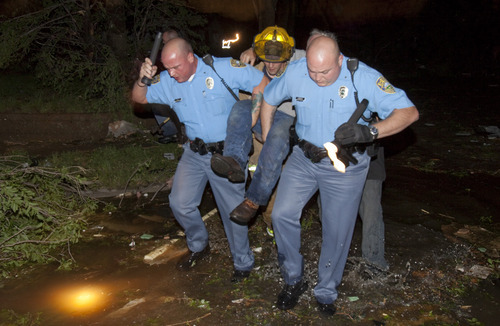 Sheriff's deputies carry out an injured man from a south Wichita neighborhood after a tornado caused massive destruction in Wichita, Kan., late Saturday, April 14, 2012. Tornadoes were spotted across the Midwest and Plains on Saturday as an outbreak of unusually strong weather seized the region, and forecasters sternly warned that