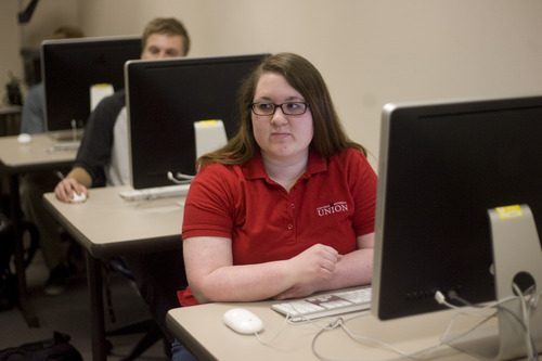 Kim Raff | The Salt Lake Tribune University of Utah senior Valerie Johnson attends a Writing for Strategic Communications class on the U. campus in Salt Lake City, still in the shirt she wears for her job at the student union building. Administrators encourage students who work to find jobs on campus, because such students graduate faster than those working off-campus. Utah students graduate with less debt than in almost any other state.