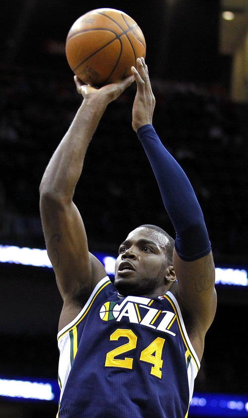 Utah Jazz's Paul Millsap shoots in the second quarter of an NBA basketball game against the New Jersey Nets, Monday, March 26, 2012, in Newark, N.J. Millsap had 24 points as Utah won 105-84. (AP Photo/Julio Cortez)