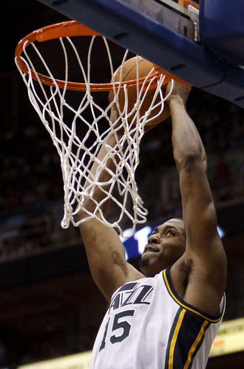 Trent Nelson  |  The Salt Lake Tribune Utah Jazz forward Derrick Favors (15) dunks the ball. Utah Jazz vs. Denver Nuggets, NBA basketball Friday, March 23, 2012 at EnergySolutions Arena in Salt Lake City, Utah.