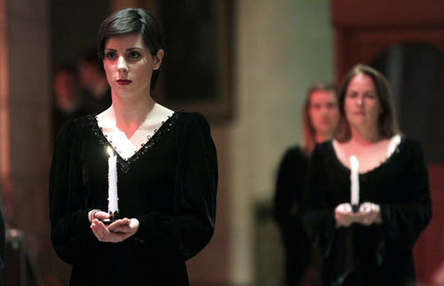 Women hold candles during a Titanic commemoration service at St. Ann's Cathedral Belfast, Northern Ireland, Saturday, April 14, 2012.  A century after the great ship went down with the loss of 1,500 lives, events around the globe are marking a tragedy that retains a titanic grip on the world's imagination - an icon of Edwardian luxury that became, in a few dark hours 100 years ago, an enduring emblem of tragedy. (AP Photo/Peter Morrison)