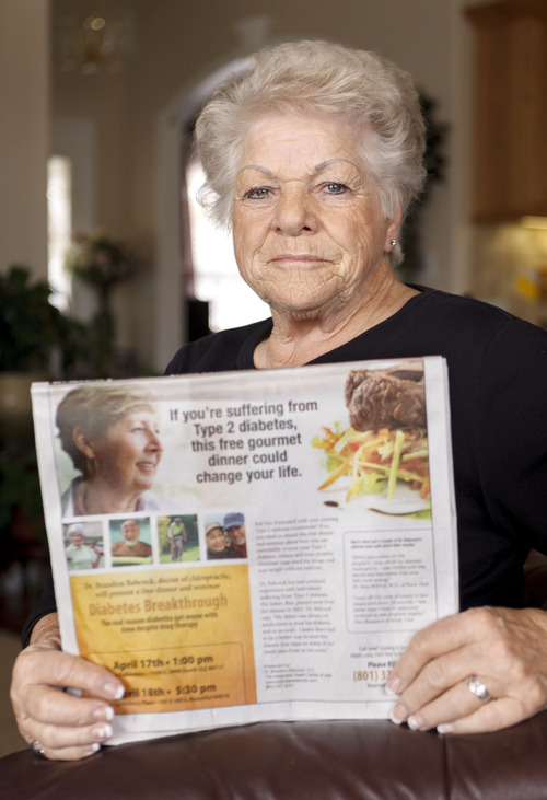 Trent Nelson  |  The Salt Lake Tribune Betty Burgener says she fell victim to a scam by chiropractor Brandon Babcock. Burgener was photographed in her home holding a copy Babcock's newspaper advertisement offering a breakthrough in the treatment of diabetes, Tuesday, April 17, 2012 in Mountain Green, Utah.
