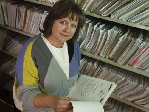 Leah Hogsten     The Salt Lake Tribune Bankruptcy lawyer Marji Hanson next to the files of her bankruptcy clients with student debts that they can't repay. Most of her clients file for bankruptcy so their other debts can be discharged, which makes it a little easier to repay student loans, or they file a Chapter 13 bankruptcy, which doesn't discharge their student loans, but buys them some time.